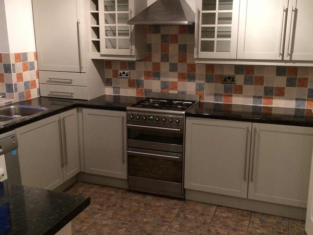 Repainted stained cherry kitchen in Bramhall